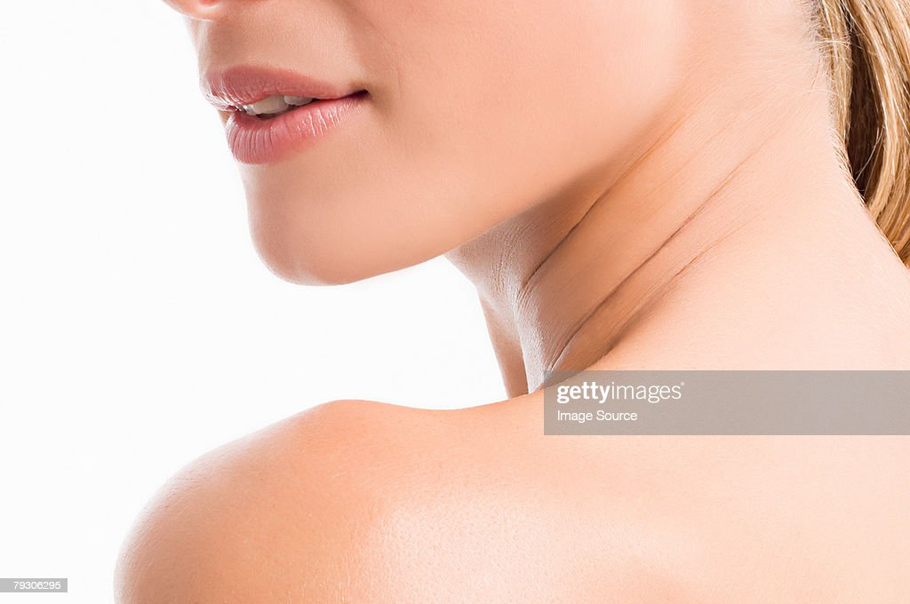 Chin neck and shoulder of a woman : Stock Photo