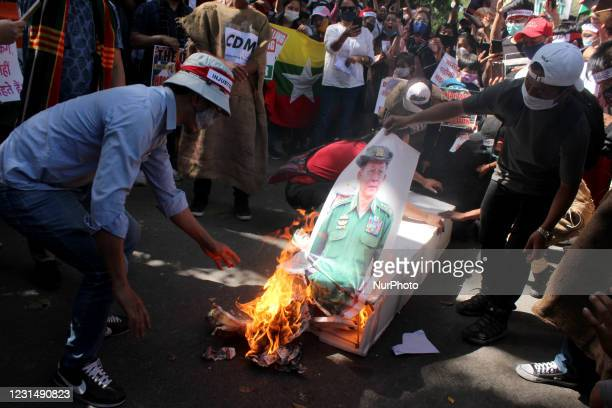 Chin refugees from Myanmar shout slogans as they burn symbolic coffins of Myanmar's Commander in chief, Senior General Min Aung Hlaing and Chinese...