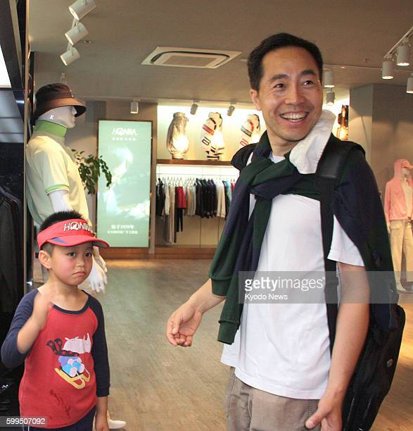 SHANGHAI China A Chinese man visits a shop of Honma Golf Co in Shanghai in June 2012 to find a children's golf club for his son
