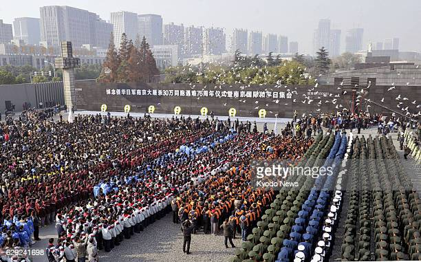 NANJING China A memorial ceremony is held for victims in the Nanjing Massacre by Japanese forces in front of the Nanjing Massacre Memorial Hall in...