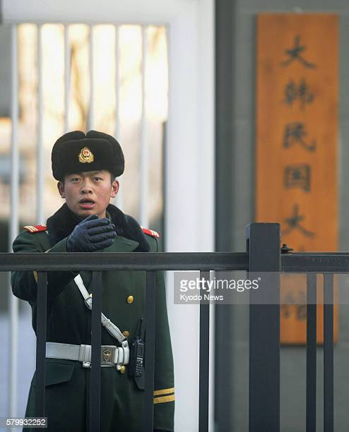 China - A police officer stands guard in front of the South Korean Embassy in Beijing on Dec. 14, 2011. On the previous day, the embassy was hit by...