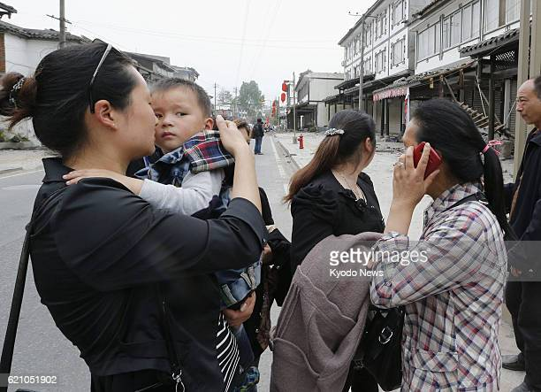 YA'AN China A woman embraces a child as a strong aftershock occurs in Lushan county in Ya'an in the southwestern Chinese province of Sichuan on April...