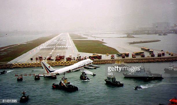 China Airlines 747 sits in the water after skidding off the runway at Kai Tak airport in Hong Kong 04 November 1993 Foul weather and a slippery...