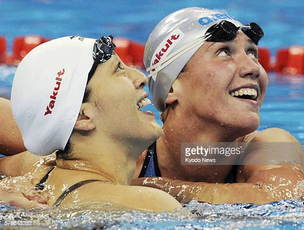SHANGHAI China Anastasia Zueva of Russia and Aya Terakawa of Japan congratulate each other after the women's 50meter backstroke final at the world...