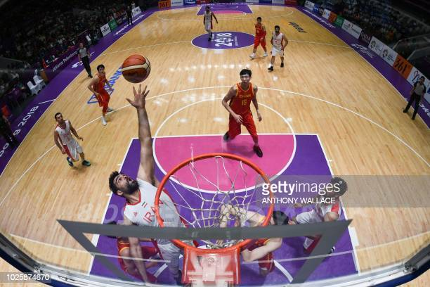 China and Iran's players compete for the ball during the men's gold medal basketball match between Iran and China at the 2018 Asian Games in Jakarta...