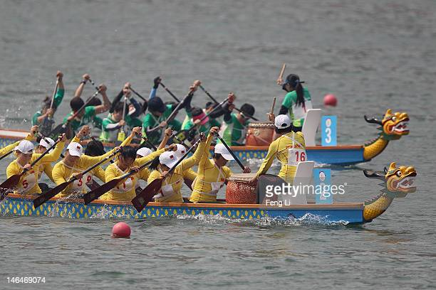 China and Macao teams complete in the Dragon Boat Women's 500m Straight Race Heat on Day 1 of the 3rd Asian Beach Games Haiyang 2012 at Jiulong Lake...