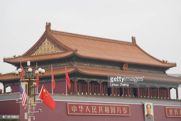 China and US flag is displayed in front of the Forbidden City on November 9 2017 in Beijing China At the invitation of Chineses President Xi Jinping...