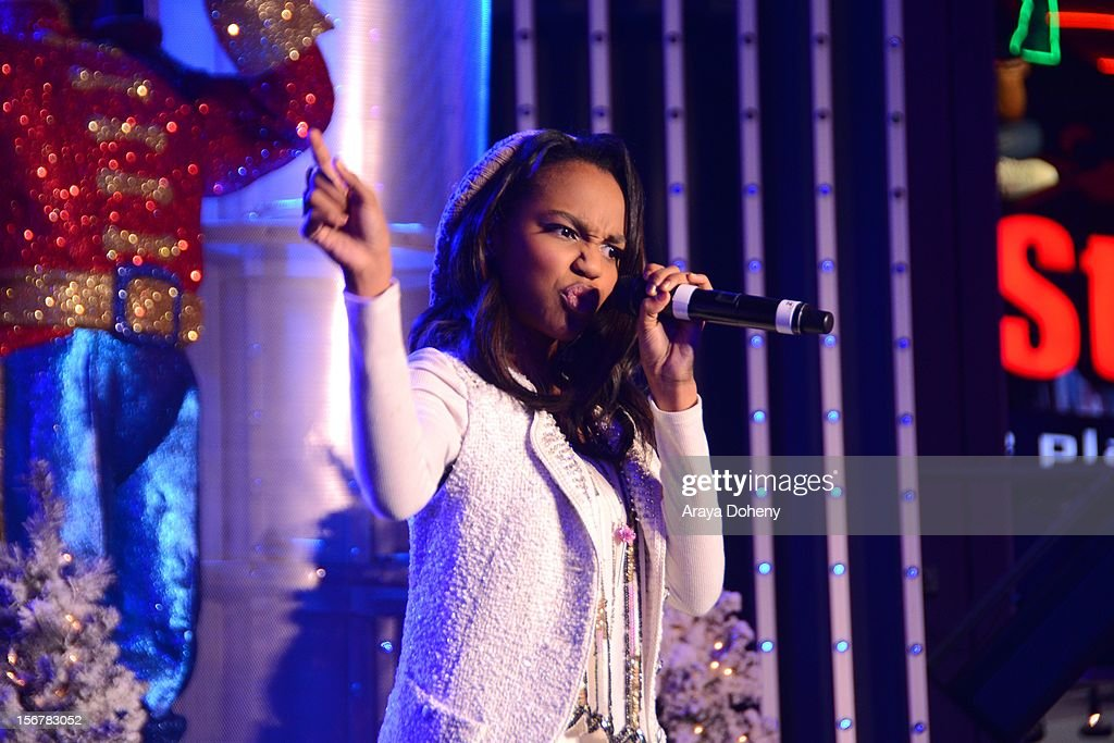 China Anne McClain performs at the 2012 Hollywood Christmas Parade Concert at Universal CityWalk on November 20, 2012 in Universal City, California.