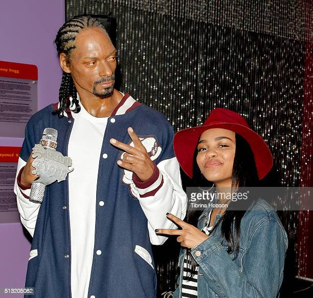 China Anne McClain poses with a wax figure of Snoop Dogg at the One Direction wax figure launch at Madame Tussauds on November 24, 2014 in Hollywood,...