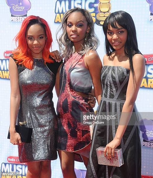 China Anne McClain Sierra McClain and Lauryn McClain of McClain Sisters arrive at the 2014 Radio Disney Music Awards at Nokia Theatre LA Live on...