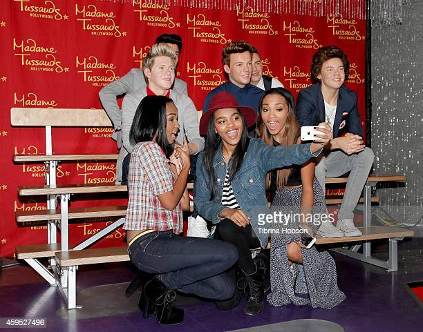 China Anne McClain, Sierra McClain and Lauryn McClain of McClain take a selfie at the One Direction wax figure launch at Madame Tussauds on November...