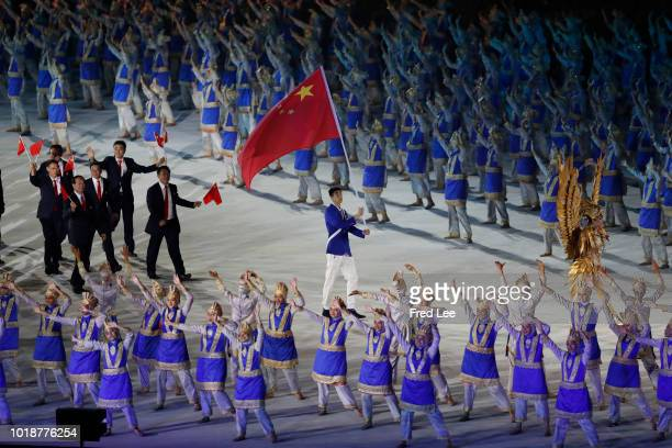 China athletes parade during the opening ceremony of the Asian Games 2018 at Gelora Bung Karno Stadium on August 18, 2018 in Jakarta, Indonesia.