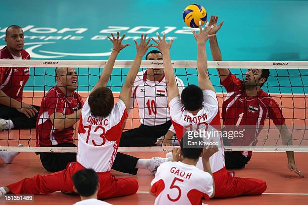 China attempt to block a shot by Hesham Abdelmaksod of Egypt during the men's Sitting Volleyball 58 Clasification match on day 8 of the London 2012...