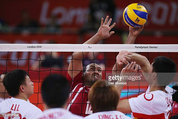 China attempt to block a shot by Mohamed Ibrahim of Egypt during the men's Sitting Volleyball 58 Clasification match on day 8 of the London 2012...