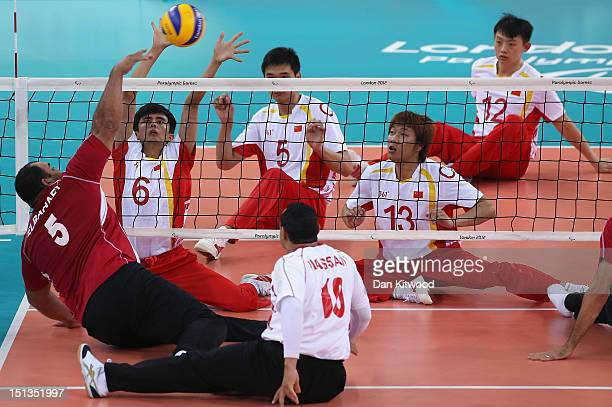 China attempt to block a shot byTaher Adel Elbahaey of Egypt during the men's Sitting Volleyball 58 Clasification match on day 8 of the London 2012...