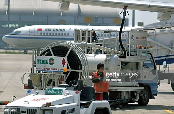 China Aviation Oil Corp fuel truck refuels a plane at Beijing's Shoudu Capital Airport Wednesday May 11 2005 CAO forced to seek bankruptcy protection...