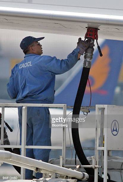China Aviation Oil Corp technician refuels a plane at Beijing's Shoudu Capital Airport Wednesday May 11 2005 CAO forced to seek bankruptcy protection...