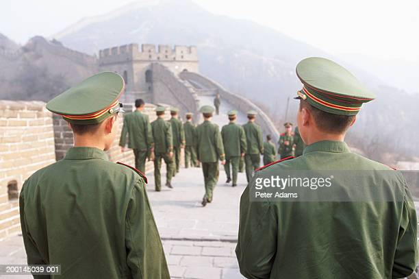 china, badaling, soldiers on the great wall of china, rear view - uniform cap stock pictures, royalty-free photos & images