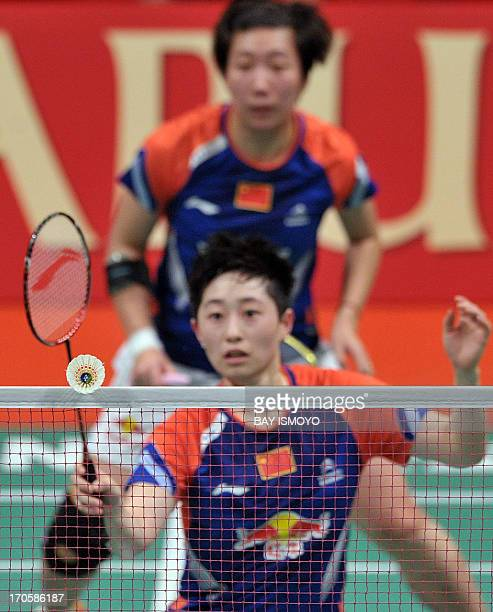 China badminton players Yu Yang and Wang Xiaoli return the shuttlecock against Ma Jin and Tang Jinhua from China during the Indonesian Open Super...