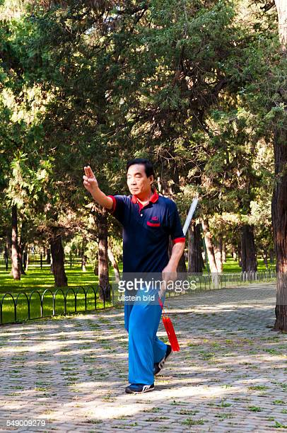 China Beijing A man practises Tai Chi on the grounds of the temple comlex of the Temple of Heaven
