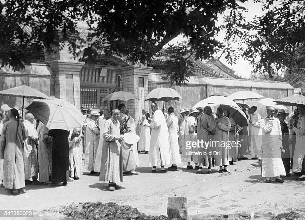 China Beijing Beijing The eunuchs who were in the imperial service waiting in front of the Palace in Beijing which they had to left by command of the...