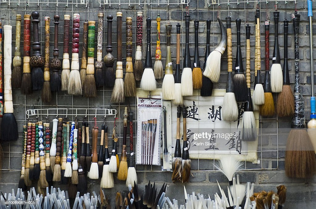 China, Beijing, Calligraphy brushes hanging on wall in shop : Stockfoto