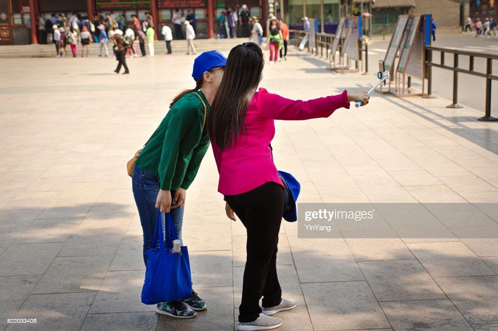 China Beijing Chinese Tourists Vacation Taking Selfie Photo with Smart Phone Camera : Stock Photo