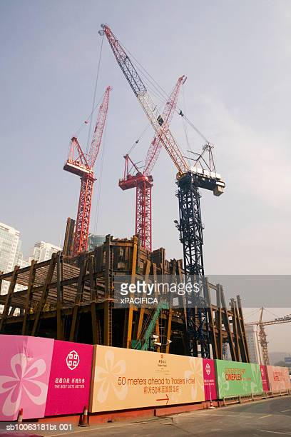 China, Beijing, construction site with cranes and posters