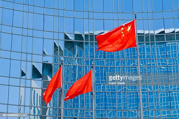 china, beijing, flag in front of grand hyatt hotel - beijing stock pictures, royalty-free photos & images