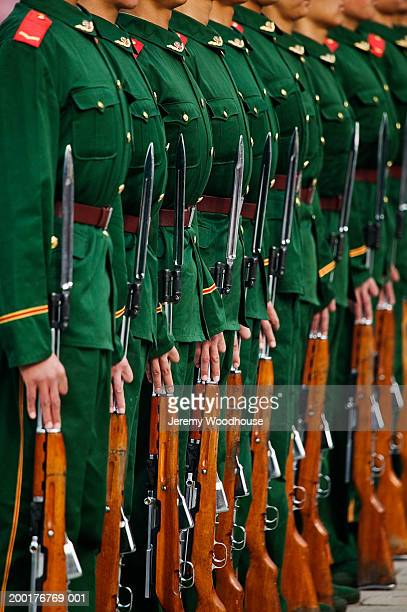 China, Beijing, Forbidden City, soldiers standing in row, mid section