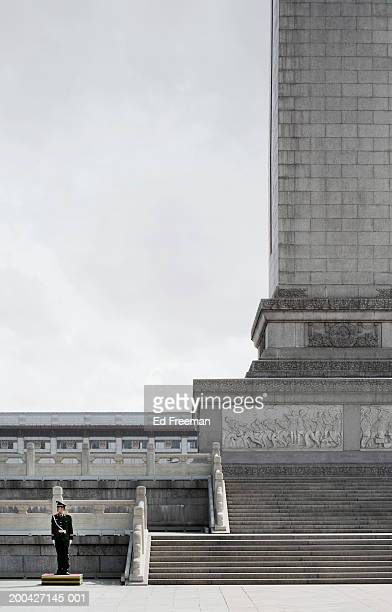china, beijing, soldier near monument to people's heroes - tiananmen square stock pictures, royalty-free photos & images
