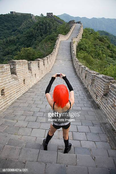 china, bejing, woman photographing great wall at mutianyu, rear view - new generation stock pictures, royalty-free photos & images