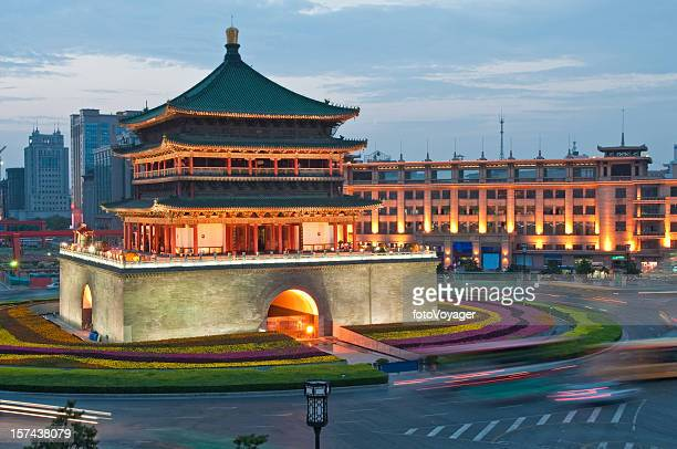 china bell tower xi'an illuminated dusk - bell tower tower stock pictures, royalty-free photos & images