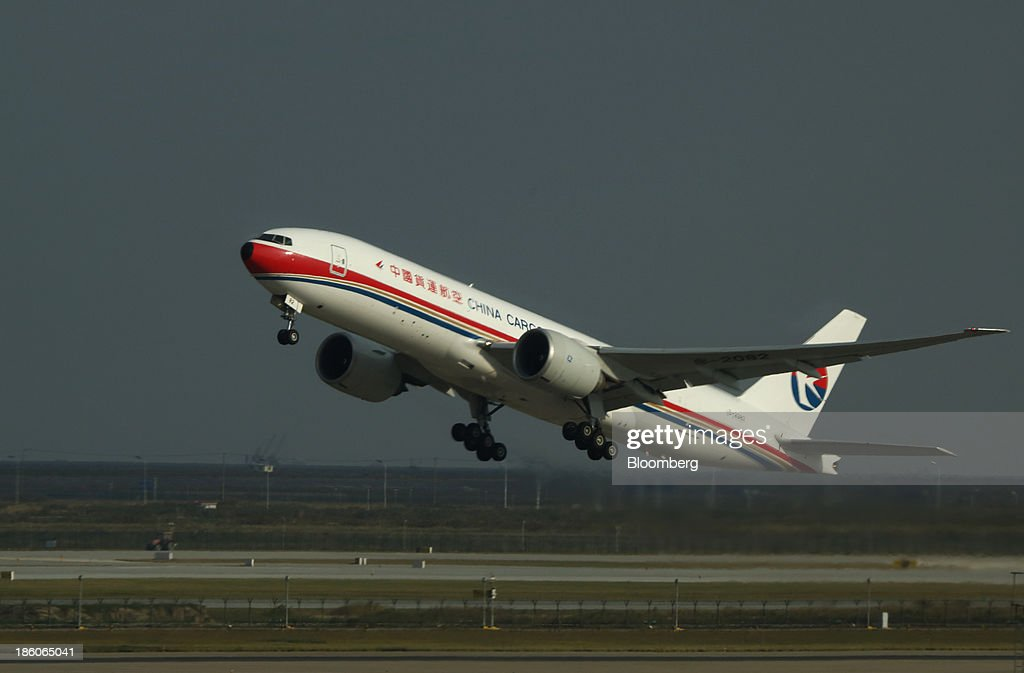 A China Cargo Airlines Co. cargo aircraft takes off at Shanghai Pudong International Airport in Shanghai, China, on Saturday, Oct. 26, 2013. Airline profits worldwide in 2013 will be 7.9 percent smaller than estimated at $11.7 billion amid sluggish travel demand and rising oil prices tied to the Syria crisis, the International Air Transport Association said last month. Photographer: Tomohiro Ohsumi/Bloomberg via Getty Images