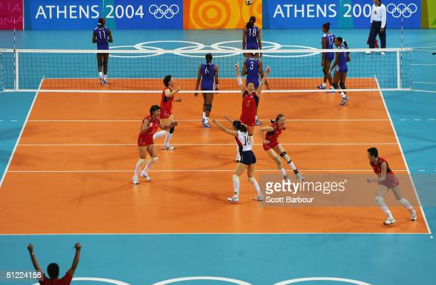 China celebrate after winning the China v Cuba women's indoor Volleyball semifinal match on August 26 2004 during the Athens 2004 Summer Olympic...