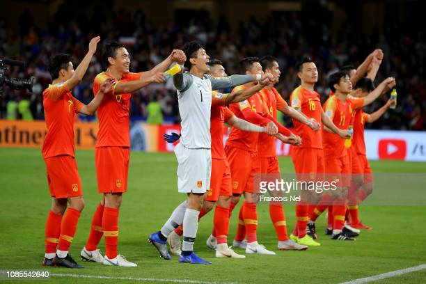 China celebrate victory in the AFC Asian Cup round of 16 match between Thailand and China at Hazza Bin Zayed Stadium on January 20, 2019 in Al Ain,...