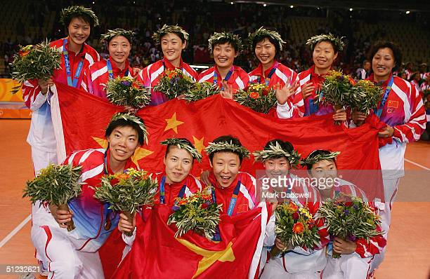 China celebrates after winning the gold medal in women's indoor volleyball during ceremonies on August 28 2004 during the Athens 2004 Summer Olympic...