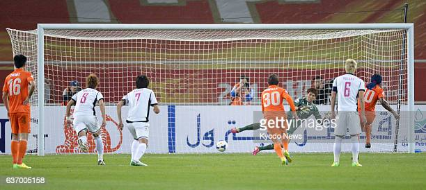 JINAN China Cerezo Osaka goalkeeper Kim Jin Hyeon is beaten by a firsthalf penalty from Shandong Luneng midfielder Walter Montillo in the Japanese...