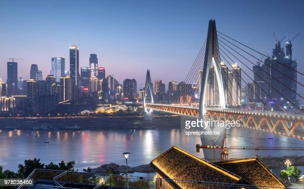 china chongqing suspension bridge with skyline - chongqing stock photos and pictures