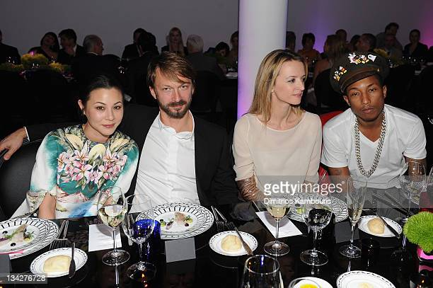 China Chow Anselm Reyle Delphine Arnault and Pharrell Williams attend the Dior popup shop featuring Anselm Reyle for Dior at Miami Design District on...