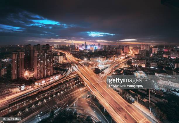 china city bridge at night, hainan province haikou city south bridge hainan airline building view - lynnhsin stock pictures, royalty-free photos & images
