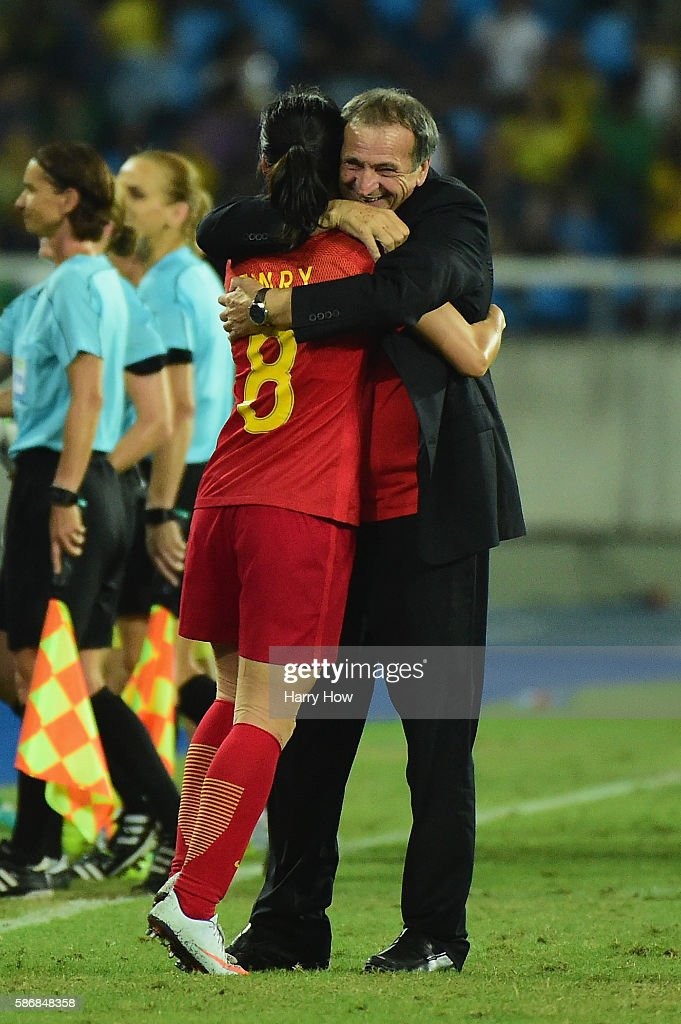 China Coach Bruno Bini embraces goalscorer Ruyin Tan following the Women's Group E first round match between South Africa and China PR on Day 1 of the Rio 2016 Olympic Games at the Olympic Stadium on August 6, 2016 in Rio de Janeiro, Brazil.