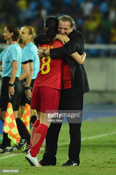 China Coach Bruno Bini embraces goalscorer Ruyin Tan following the Women's Group E first round match between South Africa and China PR on Day 1 of...