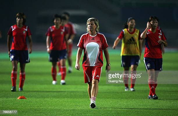 China coach Marika Domanski-Lyfors walks in front her players during a training session for the FIFA 2007 World Cup in China at Wuhan Sports Center...