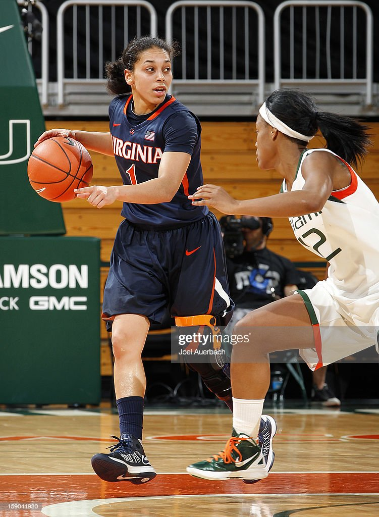 China Crosby #1 of the Virginia Cavaliers dribbles the ball against Krystal Saunders #12 of the Miami Hurricanes on January 6, 2013 at the BankUnited Center in Coral Gables, Florida. The Hurricanes defeated the Cavaliers 58-52.