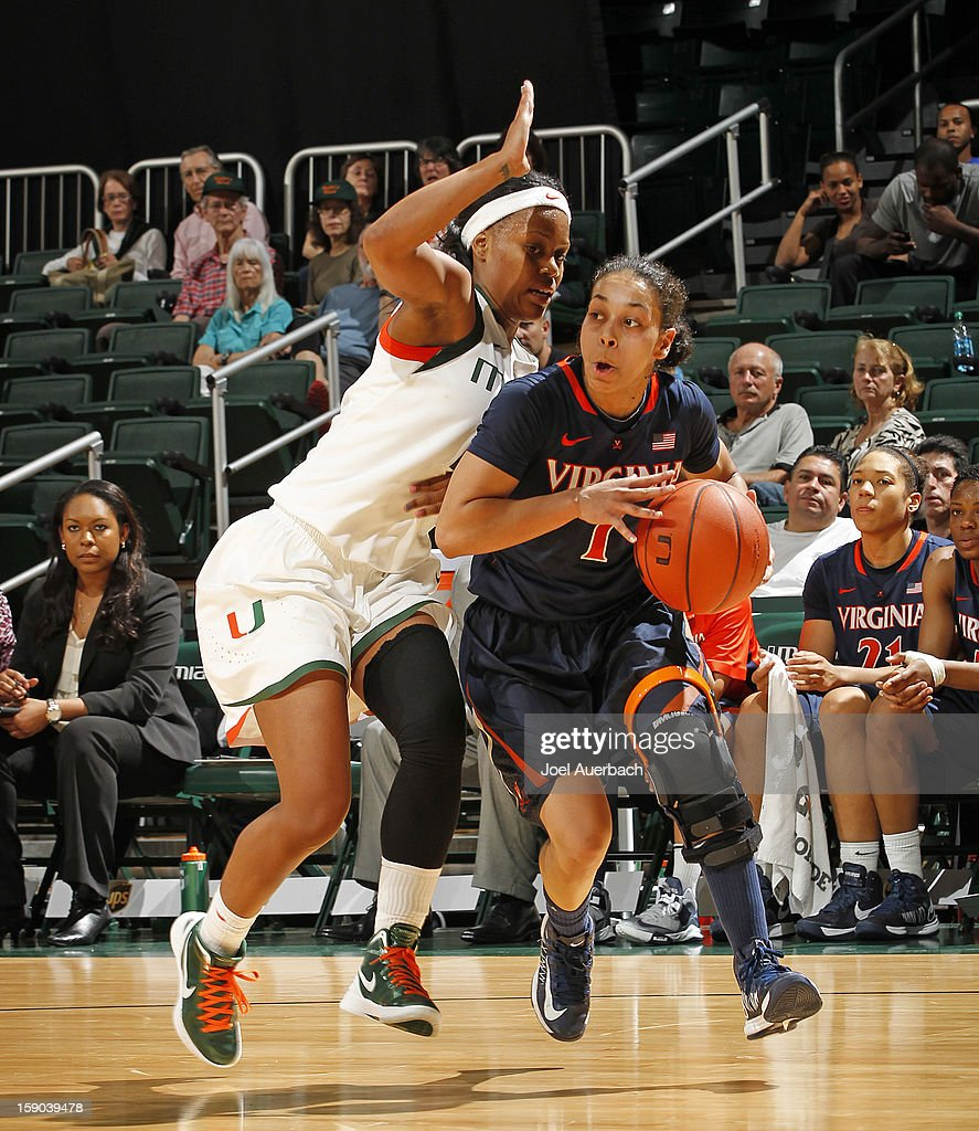 China Crosby #1 of the Virginia Cavaliers goes to the basket against Krystal Saunders #12 of the Miami Hurricanes on January 6, 2013 at the BankUnited Center in Coral Gables, Florida. The Hurricanes defeated the Cavaliers 58-52.