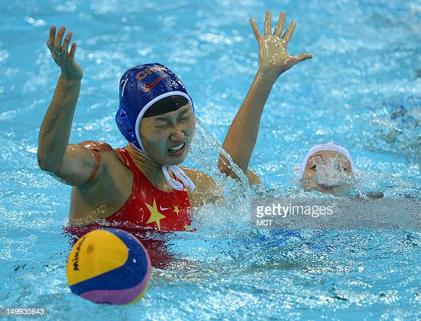 China defender Huizi Sun battle to maintain ball possession against Italy's Giulia Rambaldi right in the second half a women's water polo semifinal...