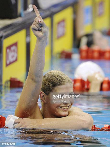 SHANGHAI China Denmark's Lotte Friis raises her arm in victory after winning the women's 1500 meters freestyle final at the world swimming...