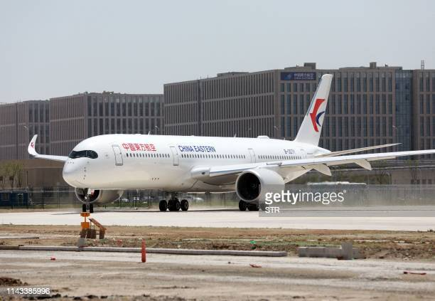 China Eastern Airlines Airbus A350-900 taxis at the new Beijing Daxing International Airport in Beijing on May 13, 2019. - Chinese airlines conducted...