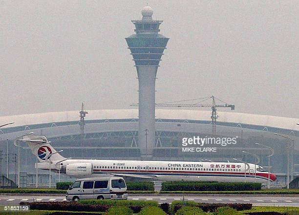 China Eastern jet taxis at Baiyun international airport on the outskirts of Guangzhou 25 November 2004 The Chinese state press reported 08 December...